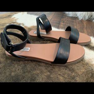 Black and tan Steve Madden sandals.